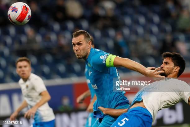 Artem Dzyuba of Zenit vies for the ball with Rodrigao of Sochi during the Russian Premier League match between FC Zenit Saint Petersburg and FC Sochi...