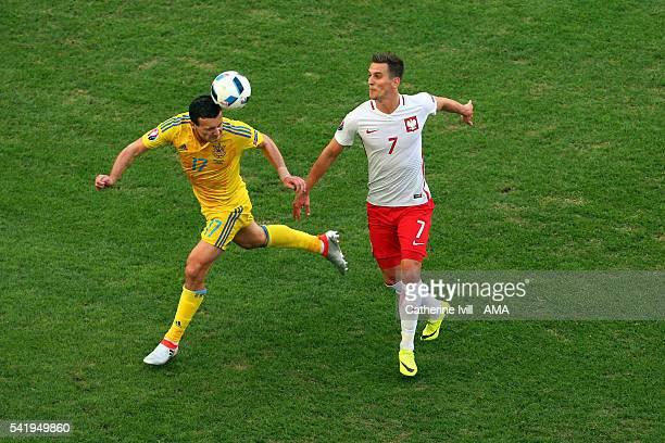 Artem Fedetskiy of Ukraine and Arkadiusz Milik of Poland during the UEFA EURO 2016 Group C match between Ukraine and Poland at Stade Velodrome on...