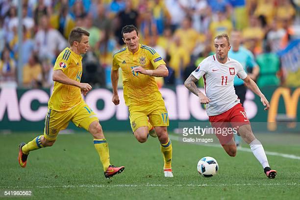Artem Fedetskiy of Ukraine and Kamil Grosicki of Poland during the UEFA Euro 2016 Group C match between Ukraine and Poland at Stade Velodrome on June...