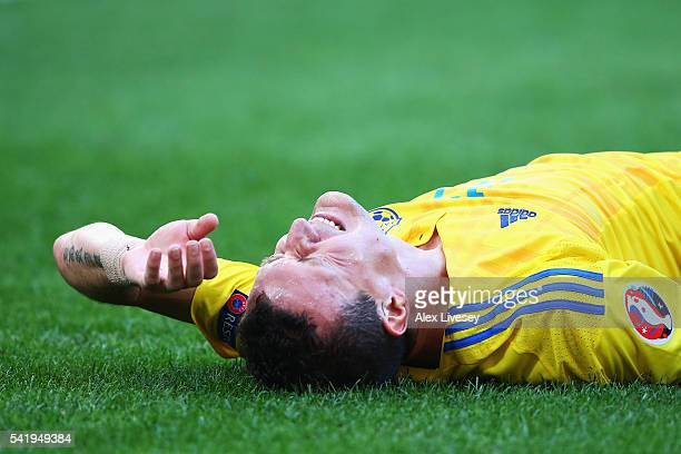Artem Fedetskiy of Ukraine lies on the floor injured during the UEFA EURO 2016 Group C match between Ukraine and Poland at Stade Velodrome on June 21...