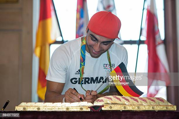 Artem Harutyunyan bronze medalist boxer signs the golden book of Frankfurt on August 23 2016 in Frankfurt am Main Germany
