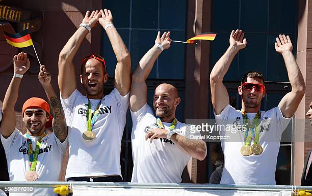 Artem Harutyunyan Max Hoff Ronald Rauhe and Sebastian Brendel celebrate during the German Olympic Team Welcome Home Reception on August 23 2016 in...