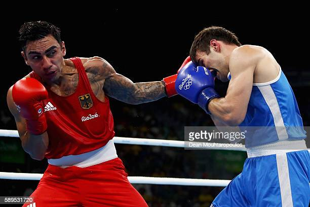 Artem Harutyunyan of Germany and Arthur Biyarslanov of Canada compete in their Light Welterweight 64kg men boxing bout on Day 9 of the Rio 2016...