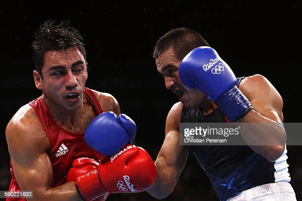 Artem Harutyunyan of Germany fights against Batuhan Gozgec of Turkey during the Men's Light Welter Quarterfinal 3 on Day 11 of the Rio 2016 Olympic...