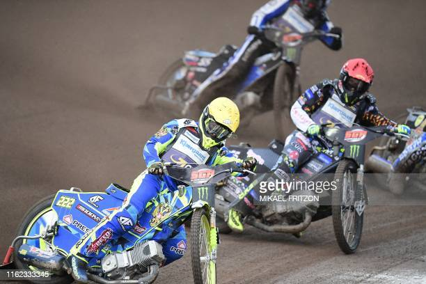 Artem Laguta of Russia followed by Fredrik Lindgren of Sweden compete during the 2019 Scandinavian FIM Speedway Grand Prix, round 6, at G&B Arena on...
