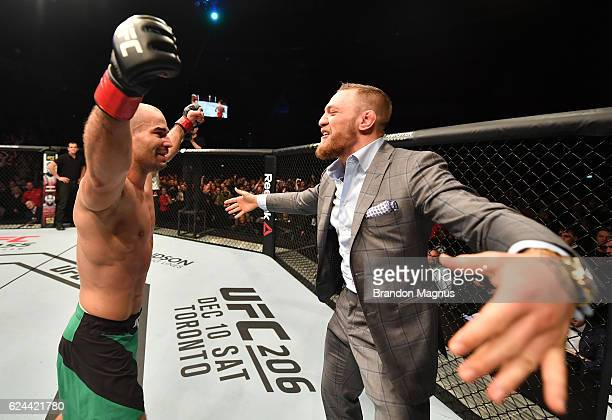 Artem Lobov of Russia celebrates with teammate and UFC champion Conor McGregor after his featherweight bout against Teruto Ishihara during the UFC...