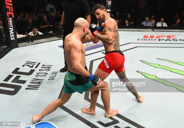 Artem Lobov of Russia punches Cub Swanson in their featherweight bout during the UFC Fight Night event at Bridgestone Arena on April 22 2017 in...
