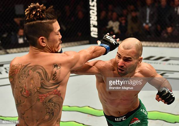Artem Lobov of Russia punches Teruto Ishihara of Japan in their featherweight bout during the UFC Fight Night at the SSE Arena on November 19 2016 in...