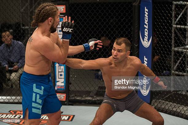 Artem Lobov punches Chris Gruetzemacher during the filming of The Ultimate Fighter: Team McGregor vs Team Faber at the UFC TUF Gym on August 18, 2015...