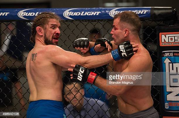 Artem Lobov punches Chris Gruetzemacher during the filming of The Ultimate Fighter Team McGregor vs Team Faber at the UFC TUF Gym on August 18 2015...