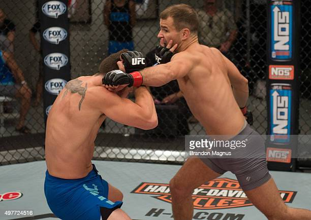 Artem Lobov punches James Jenkins during the filming of The Ultimate Fighter Team McGregor vs Team Faber at the UFC TUF Gym on August 7 2015 in Las...