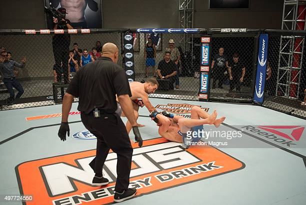 Artem Lobov punches James Jenkins during the filming of The Ultimate Fighter Team McGregor vs Team Faber at the UFC TUF Gym on August 10 2015 in Las...