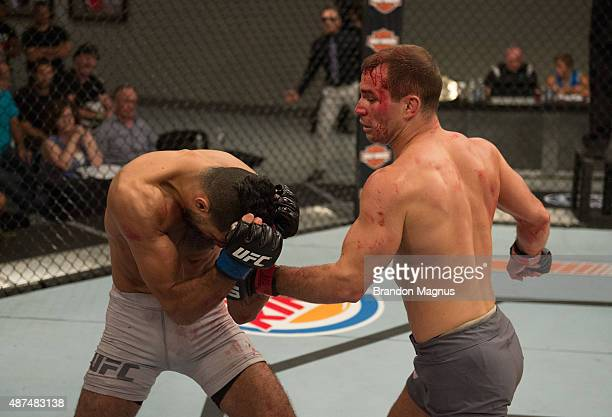 Artem Lobov punches Mehdi Baghdad during the elimination fights at the UFC TUF Gym on July 17 2015 in Las Vegas Nevada