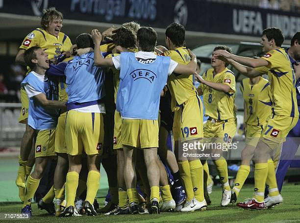 Artem Milevskiy of Ukraine is mobbed by his team mates after he scores their winning goal during the UEFA U21's Championship 2006 match between...