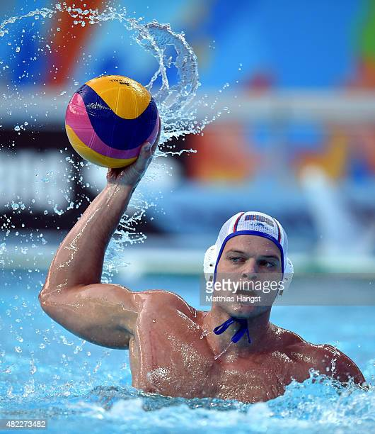 Artem Odintsov of Russia looks to pass against Italy in the Men's Water Polo Preliminary Round Group B match between Russia and Italy on day five of...