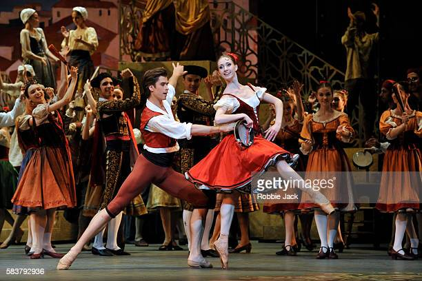 Artem Ovcharenko as Basil and Margarita Shrainer as Kitri with artists of the company in The Bolshoi Ballet's production of Marius Petipa's Don...