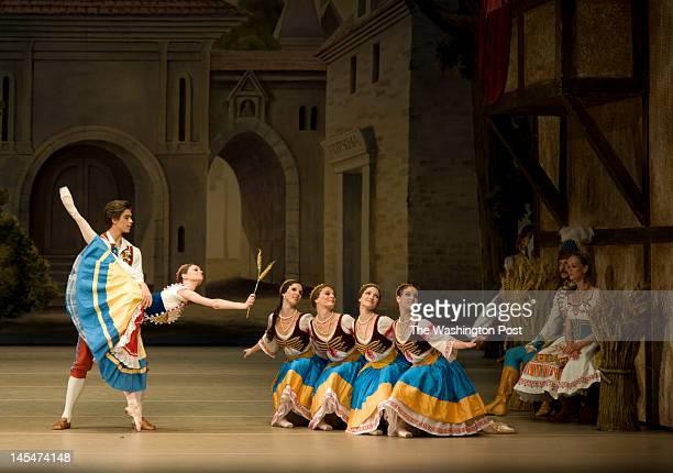 Artem Ovcharenko , center L, and Nina Kaptsova , perform a scene together during Bolshoi Ballet's performance of Petipa and Enrico Cecchetti's...