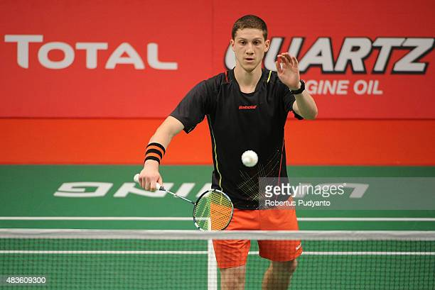 Artem Pochtarev of Ukraine competes against Sho Sasaki of Japan in the 2015 Total BWF World Championship at Istora Senayan on August 11, 2015 in...