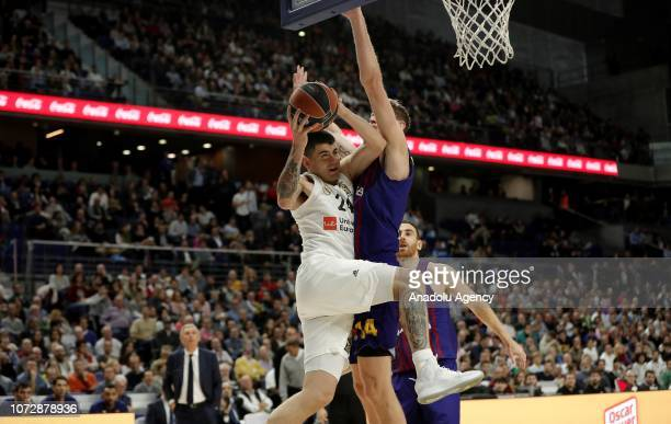 Artem Pustovyi of Barcelona Lassa in action against Gabriel Deck of Real Madrid during the Turkish Airlines Euroleague basketball match between Real...