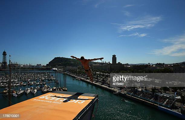 Artem Silchenko of Russia competes during the Men's 27m High Diving on day ten of the 15th FINA World Championships at Moll de la Fusta on July 29...