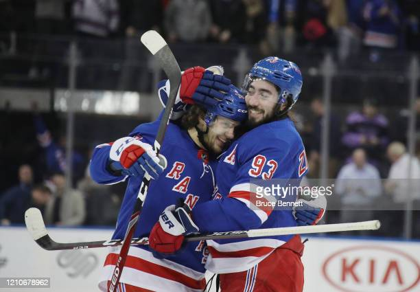 Artemi Panarin and Mika Zibanejad of the New York Rangers celebrate a 5-4 overtime victory over the Washington Capitals at Madison Square Garden on...