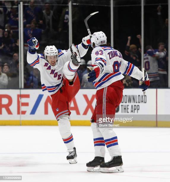 Artemi Panarin and Mika Zibanejad of the New York Rangers celebrate an game winning overtime goal by Zibanejad against the New York Islanders at NYCB...