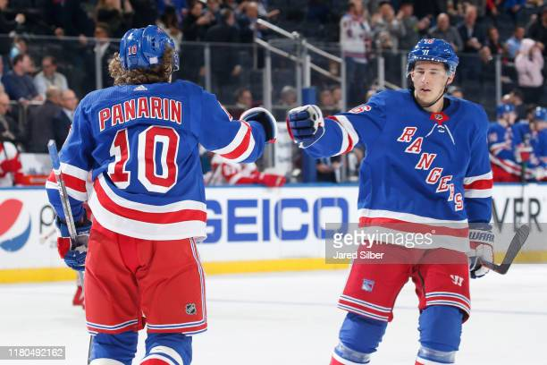 Artemi Panarin and Ryan Strome of the New York Rangers celebrate after scoring as goal in the third period against the Detroit Red Wings at Madison...