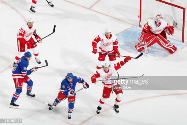 Artemi Panarin and Ryan Strome of the New York Rangers skate against Tyler Bertuzzi Dylan Larkin and Patrick Nemeth of the Detroit Red Wings at...