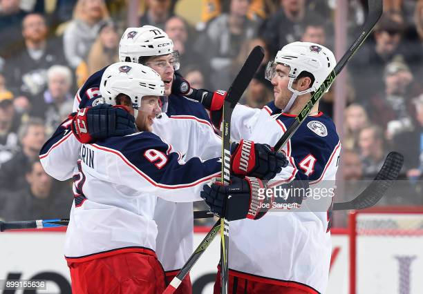 Artemi Panarin celebrates his goal with Josh Anderson and Scott Harrington of the Columbus Blue Jackets during the third period against the...