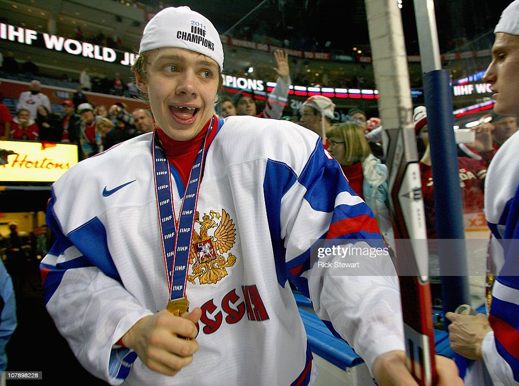 Artemi Panarin #27 of Russia celebrates with his goal medal after Russia defeated Canada 5-3 during the 2011 IIHF World U20 Championship Gold medal game between Canada and Russia at the HSBC Arena on January 5, 2011 in Buffalo, New York. Russia won 5-3. Panarin scored the game winning goal.