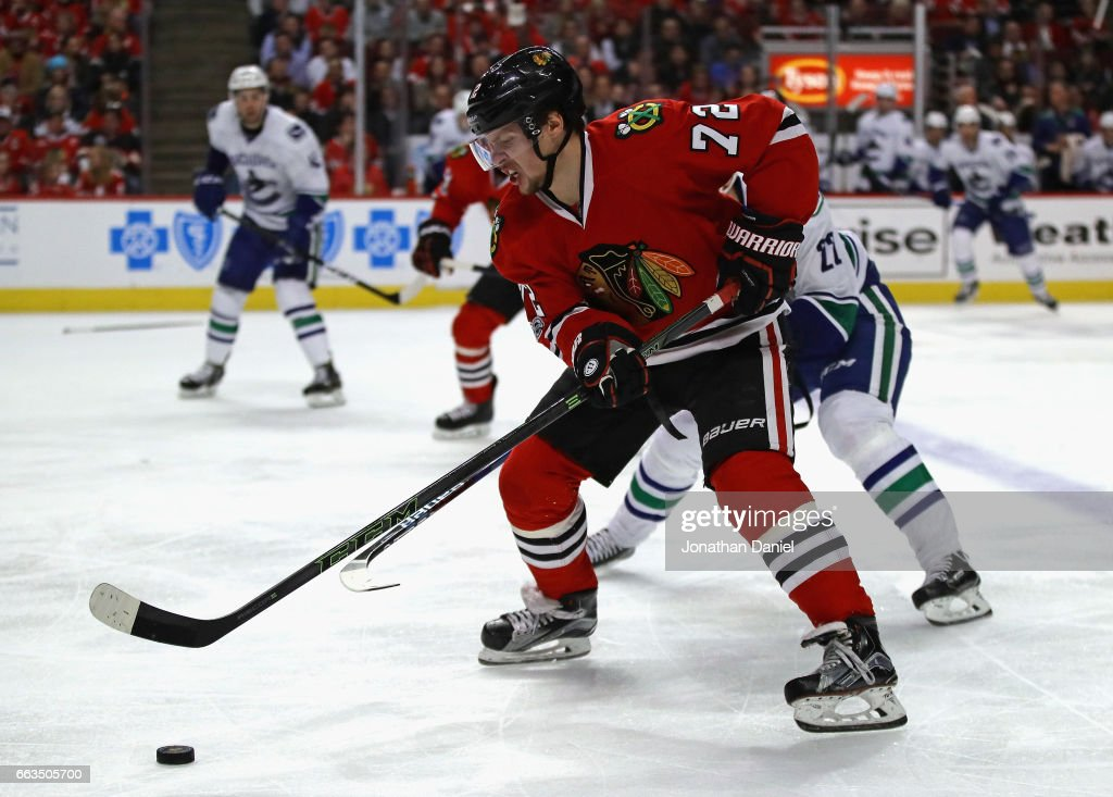 Artemi Panarin #72 of the Chicago Blackhawks advance the puck past Daniel Sedin #22 of the Vancouver Canucks at the United Center on March 21, 2017 in Chicago, Illinois. The Canucks defeated the Blackhawks 5-4 in overtime.