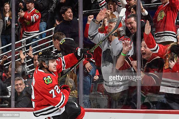 Artemi Panarin of the Chicago Blackhawks celebrates after scoring against the Pittsburgh Penguins in the first period of the NHL game at the United...