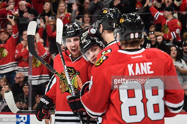 Artemi Panarin of the Chicago Blackhawks celebrates with teammates including Erik Gustafsson after scoring his second goal of the game against the...