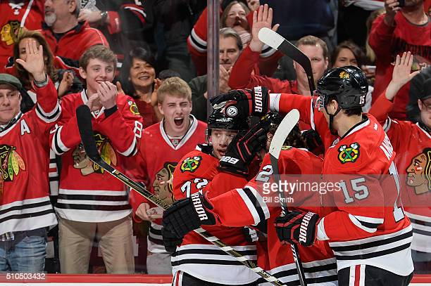 Artemi Panarin of the Chicago Blackhawks celebrates with teammates after scoring in the third period of the NHL game against the Toronto Maple Leafs...