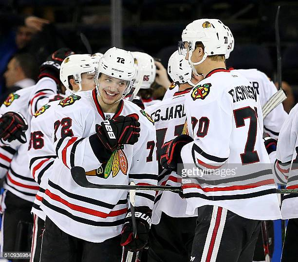Artemi Panarin of the Chicago Blackhawks celebrates with teammates after the game against the New York Rangers at Madison Square Garden on February...