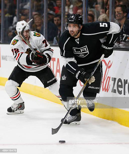 Artemi Panarin of the Chicago Blackhawks defends against Jamie McBain of the Los Angeles Kings during a game at Staples Center on November 28 2015 in...
