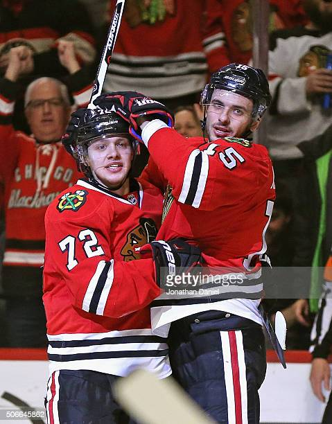 Artemi Panarin of the Chicago Blackhawks gets a hug from Artem Anisimov after scoring a second period goal against the St Louis Blues at the United...