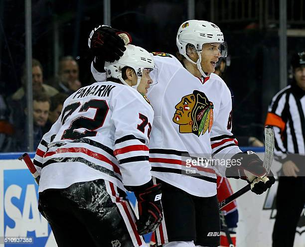 Artemi Panarin of the Chicago Blackhawks is congratulated by teammate Patrick Kane after he scored a hat trick in the third period against the New...