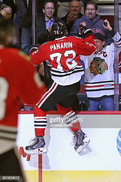 Artemi Panarin of the Chicago Blackhawks jumps off the glass to celebrate his third period goal against the Edmonton Oilers at the United Center on...
