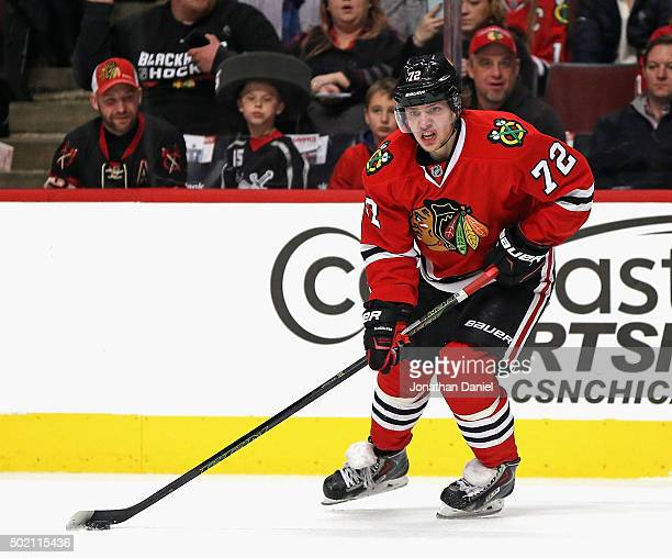 Artemi Panarin of the Chicago Blackhawks looks to pass against the Edmonton Oilers at the United Center on December 17 2015 in Chicago Illinois The...