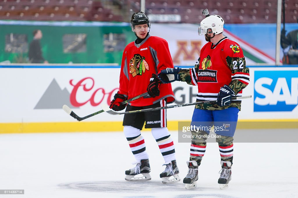 Artemi Panarin #72 of the Chicago Blackhawks speaks to a member of the Wounded Warrior hockey team during practice day for the 2016 Coors Light Stadium Series game against the Minnesota Wild at TCF Bank Stadium on February 20, 2016 in Minneapolis, Minnesota.