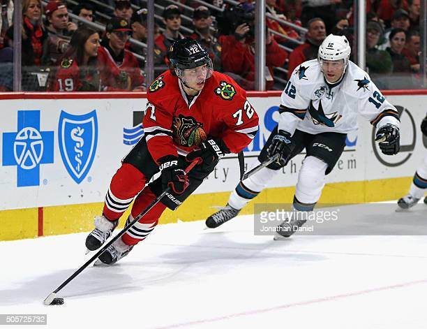 Artemi Panarin of the Chicago Blackhawks turns with the puck in front of Patrick Marleau of the San Jose Sharks at the United Center on December 20...
