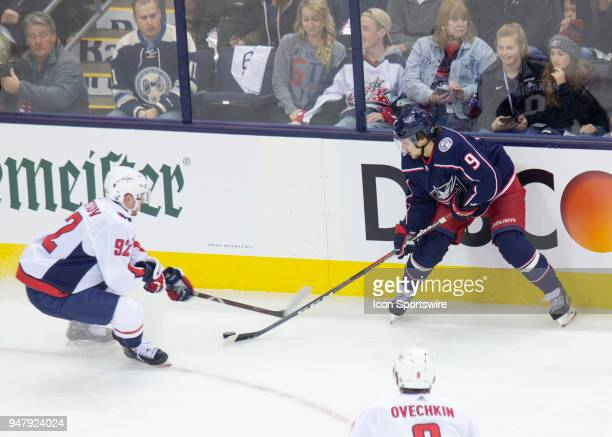 Artemi Panarin of the Columbus Blue Jackets and Evgeny Kuznetsov of the Washington Capitals battle for the puck during game 3 in the First Round of...