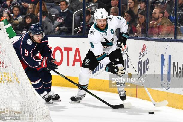 Artemi Panarin of the Columbus Blue Jackets and Joe Pavelski of the San Jose Sharks skate after a loose puck during the third period of a game on...