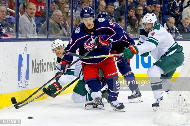 Artemi Panarin of the Columbus Blue Jackets and Matt Cullen of the Minnesota Wild battle for control of the puck during the game on January 30 2018...