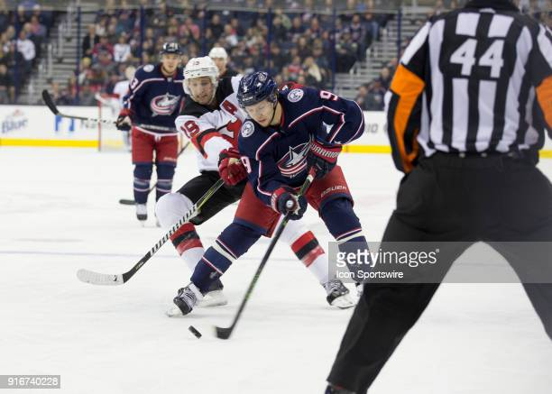 Artemi Panarin of the Columbus Blue Jackets and Travis Zajac of the New Jersey Devils battle for the puck during the first period of the game between...