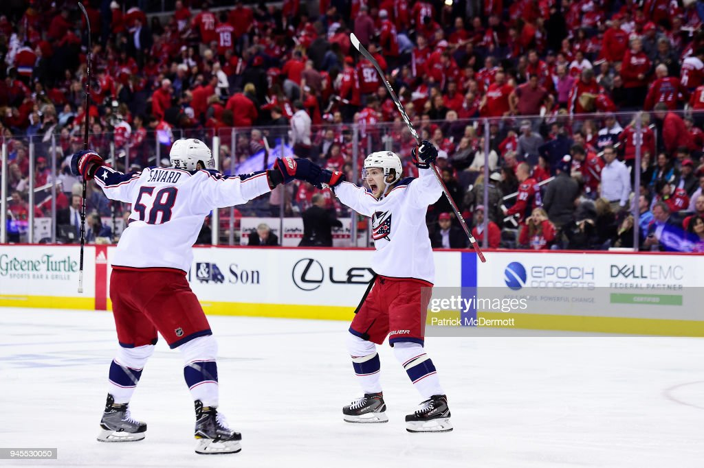 Artemi Panarin #9 of the Columbus Blue Jackets celebrates with David Savard #58 after scoring the game-winning goal in overtime against the Washington Capitals in Game One of the Eastern Conference First Round during the 2018 NHL Stanley Cup Playoffs at Capital One Arena on April 12, 2018 in Washington, DC.