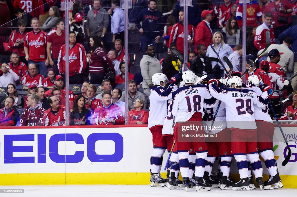 Artemi Panarin #9 of the Columbus Blue Jackets celebrates with his teammates after scoring the game-winning goal in overtime against the Washington Capitals in Game One of the Eastern Conference First Round during the 2018 NHL Stanley Cup Playoffs at Capital One Arena on April 12, 2018 in Washington, DC.
