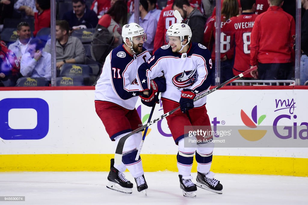 Artemi Panarin #9 of the Columbus Blue Jackets celebrates with Nick Foligno #71 after scoring the game-winning goal in overtime against the Washington Capitals in Game One of the Eastern Conference First Round during the 2018 NHL Stanley Cup Playoffs at Capital One Arena on April 12, 2018 in Washington, DC.