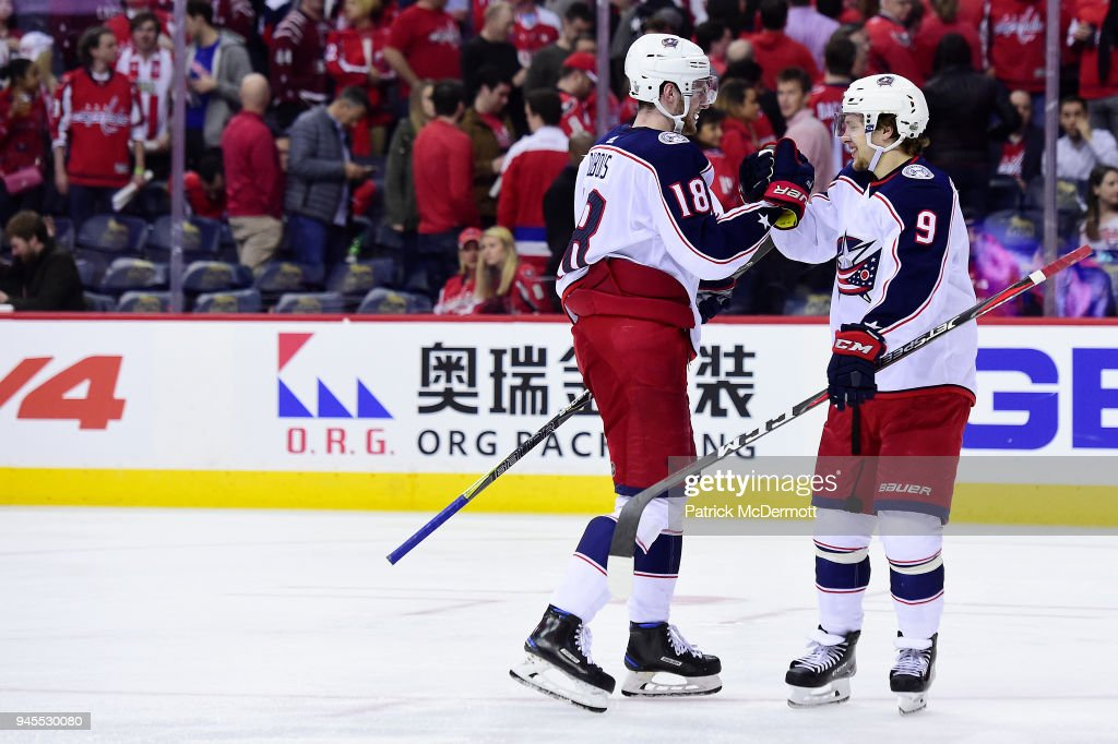 Artemi Panarin #9 of the Columbus Blue Jackets celebrates with Pierre-Luc Dubois #18 after scoring the game-winning goal in overtime against the Washington Capitals in Game One of the Eastern Conference First Round during the 2018 NHL Stanley Cup Playoffs at Capital One Arena on April 12, 2018 in Washington, DC.
